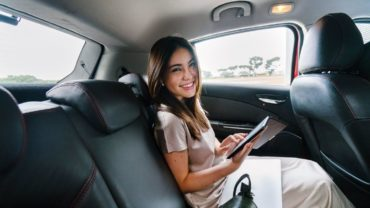 Description: Smiling Woman Sitting Inside Car