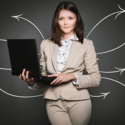 A woman holding a laptop who can provide her clients with professional website maintenance.